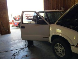 Working on a Chevy S10 inside a customers garage.